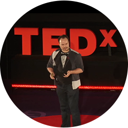 A photo about Benny as a TED speaker